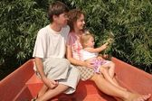 Father and mother with the daughter in the boat — Stock Photo