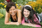 Mother with daughter lies on grass — Stock Photo
