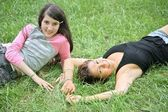 Mother and daughter-teenager lie on the grass 2 — Stockfoto