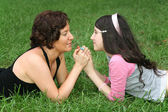 Mother with teenager on grass lie — Stockfoto