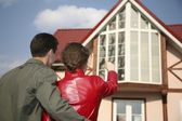 Young couple and house — Stock Photo
