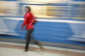 Motion girl with train — Stock Photo