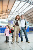 Family with girl in airport — Stock Photo