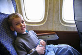 Child sit in plane — Stock Photo