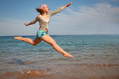 The girl in a jump on the sea — Foto Stock