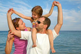 Mother, daughter and father on the sea — Stock Photo
