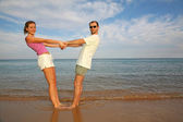 Man and woman on a beach — Stock Photo
