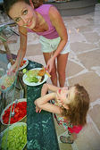 Mother and the daughter choose meal — Stock Photo