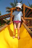 Tropical girl on slide — Stock Photo