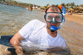 Man with snorkel in mouth — Stock Photo
