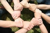 Eight friends have crossed hands — Stock Photo