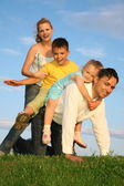 Playing family grass sky — Stock Photo