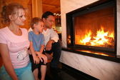 Family and fireplace — Stock Photo