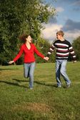 Attractive couple walking outdoors together — Stock Photo