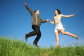Man woman jumping — Stockfoto