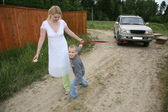 Mother with the son they pull automobile on the rope — Stok fotoğraf