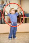 Baby play with hoop — Stock Photo
