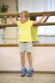 Little boy in sport hall — Stock Photo