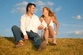 Pair sits on to the meadow — Stock Photo
