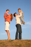 Daddy and mommy hold children on the hands — Stock Photo