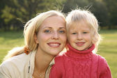 Autumn mother with girl — Stock Photo