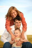 Mom embraces husband with the son — Stock Photo