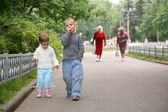 Children on the path in the park — Stock Photo