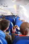 Passengers in the aircraft from behind — Stock Photo