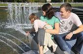Family at fontain — Stock Photo