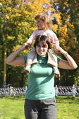 Baby on mother shoulders — Stock Photo