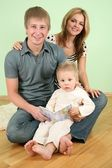 Child with book and parents 2 — Stock Photo