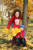 Family in the park in autumn — Stock Photo