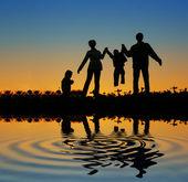 Familie van vier zonsondergang 2 — Stockfoto
