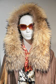 Mannequin woman with fur with glasses — Stock Photo
