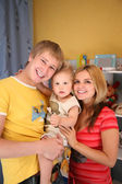 Parents and son in playroom — Stock Photo