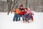 Family in forest at winter — Stock Photo