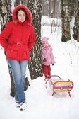 Mother and child stand in park at winter — Stock Photo