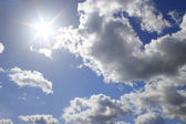 Real sun on cloud sky — Stock Photo
