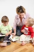 Children looking books with mother 2 — Stock Photo