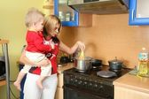 Mother with child on kitchen — Stock Photo