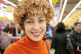 Young woman with bright tinsel in store — Stock Photo
