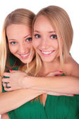 Twin girls embrace from behind — Stock Photo