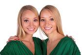 Twin gils embrace close-up — Stock Photo