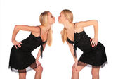 Twin girls face-to-face incline to each other — Stock Photo