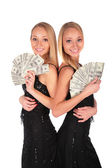 Twin girls with Dollars — Stock Photo
