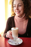 Yuong woman with glass of whipped cream 2 — Stock Photo
