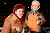 Mother and son with sparklers — Stock Photo
