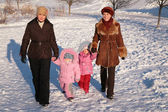 Two mothers with children on walk in winter — Stock Photo