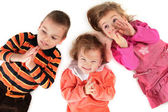 Three children lying top view close-up — Stock Photo