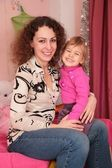 Mother with child on the lap in the room — Stock Photo